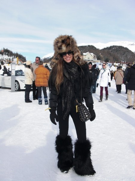 Me in a black overall with fur details and fur boots, both PRADA SPORT, hat DOLCE & GABBANA, scarf GUCCI and sunglasses BALENCIAGA.