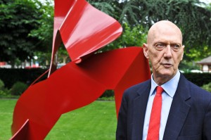 Allen Jones in front of his sculpture