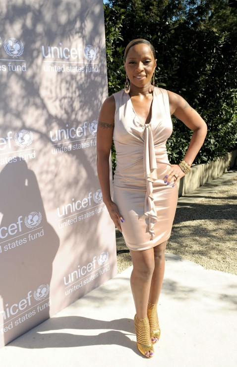 Singer Mary J. Blige in a nude sleeveless crêpe viscose jersey Gucci dress with ruffle-front detailing.