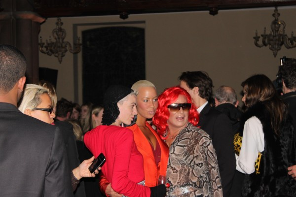 "Model Amber Rose framed by other ""ladies"" in red"