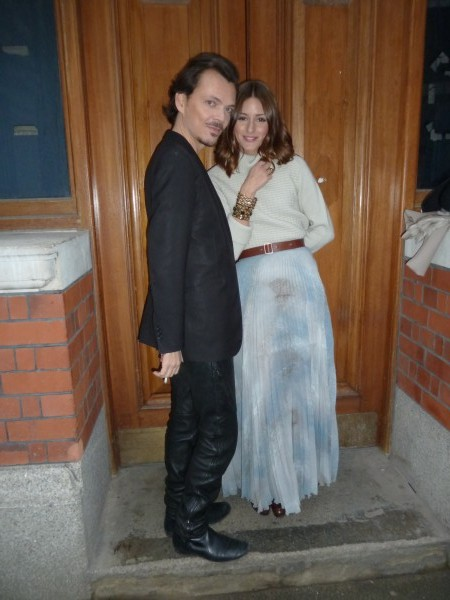 Matthew Williamson smoking a cigarette with Olivia Palermo before the show.