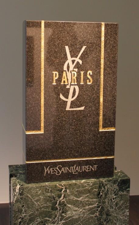 Untitled (YSL), Black granite tombstone and gold leaf, 2010