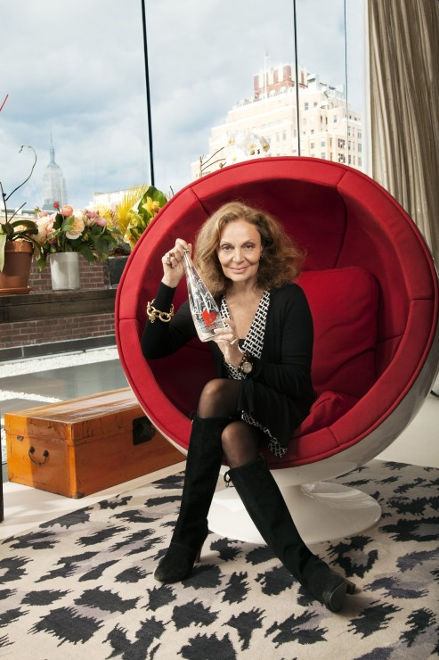 DVF holding bottle