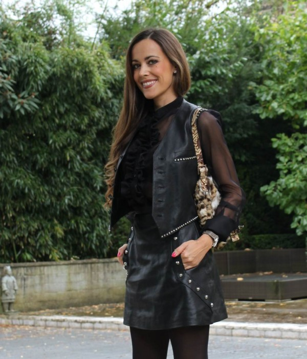 Sandra Bauknecht in Leo Biker Vest and studded leather skirt by Saint Laurent