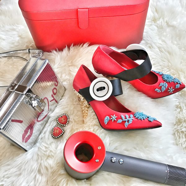 c915a18ad00 Getting ready for Valentine s Day  printed metallic leather box clutch by  Dolce   Gabbana, earrings by Chanel, embellished satin pumps by Prada and  my ...