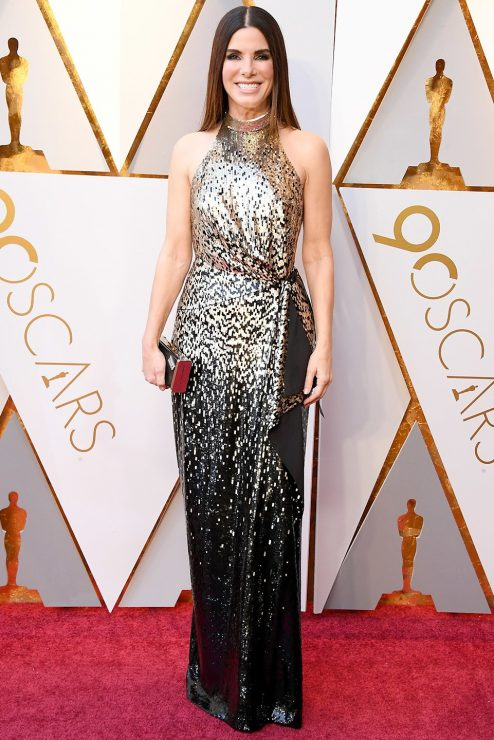 84fdbe3692e2 Back after her last Oscars appearance in 2014  Sandra Bullock walked the  red carpet in a custom silk gown from Louis Vuitton which I personally find  very ...