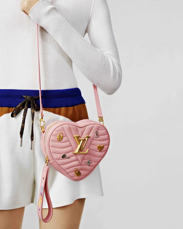 adff10f312dc The Heart bag comes in blush pink and scarlet with the LV Love locks